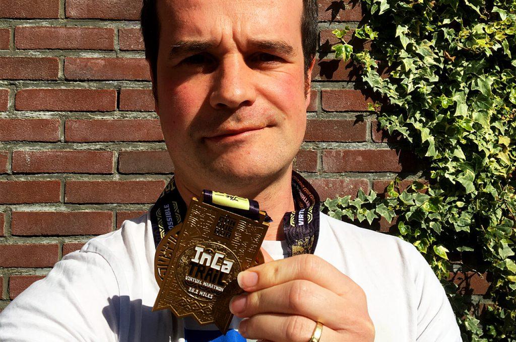 Mijn virtueel hardlopen medaille van The Conqueror